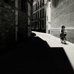 * (motocchio) Tags: street summer bw italy monochrome bicycle square alley italia july lucca bici toscana 2009 bicicletta explored artlibre gx200