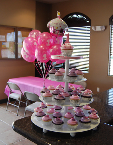 purple and pink 1st birthday cupcake tower with balloons