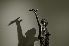 boy holding toy plane (Leo Reynolds) Tags: bw sculpture photoshop canon eos duotone iso1600 f40 41mm 005sec 40d hpexif leol30random grouplondon grouptwtme threadtwtme threadtwtme2mon groupblackwhite groupsepiabw xleol30x xxx2009xxx xratio3x2x