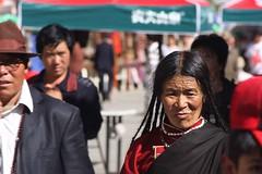 Lhasa, Barkhor (blauepics) Tags: china portrait people woman face temple asia gesicht leute earth expression religion beijing buddhism tibet menschen tibetan frau lhasa pilger humans tempel pilgrims buddhismus mimik tibeterin earthasia