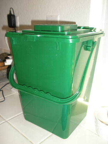 a shiny new compost bucket