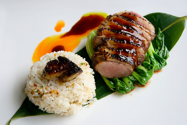 Roasted Marinated Duck Breast, Zento's Style, served with foie gras and baby bokchoy and garlic rice