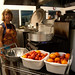 Kathy Nichols waits for the water to boil to blanch tomatoes