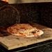 Pizza cooking in a hacked oven, at 900 F
