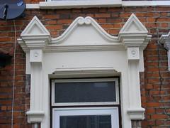 Very fine pedimented doorway moulding. Ilford (sludgegulper) Tags: kings seven ilford redbridge