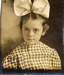 Photobooth girl with huge hair ribbon (lovedaylemon) Tags: old girl vintage booth photo check photobooth edwardian hairribbon