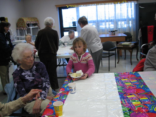 Augusta serves cake and ice cream to a nursing home resident during the January birthday party hosted by St. Johns on January 12th, 2009.