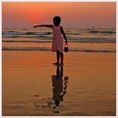 My Little Sun (JannaPham) Tags: sunset sea vacation sun india holiday reflection beach girl beauty sunrise golden little goa explore catcher majorda explorefrontpage jannapham