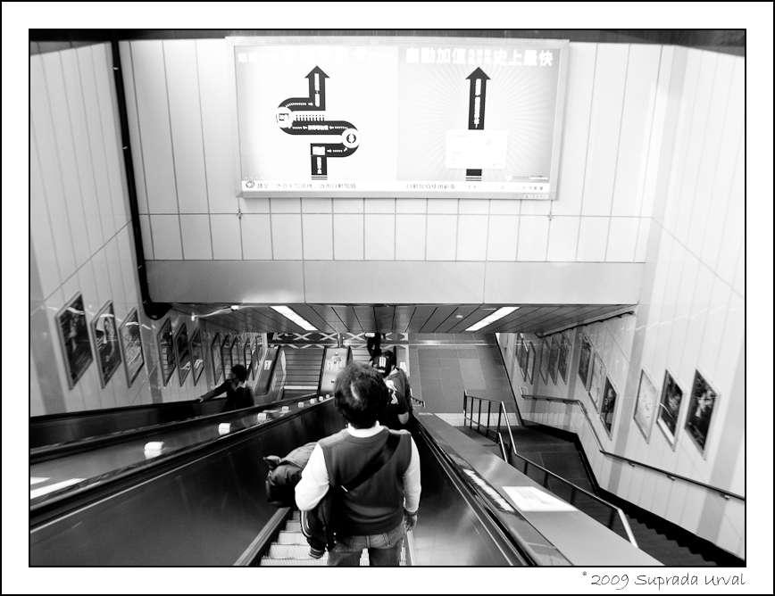 Descending into City Hall MRT station