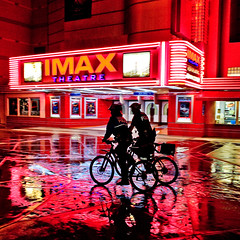 Two Cops, Two Bikes (Thomas Hawk) Tags: california usa rain bike bicycle silhouette theater neon unitedstates theatre fav50 10 unitedstatesofamerica save3 police save7 save8 delete save save2 fav20 save9 save4 photowalk sacramento save5 save10 fav30 imax savedbythedeletemeuncensoredgroup esquiretheater fav10 fav25 fav100 photowalking fav40 fav60 fav90 fav80 fav70 superfave imaxesquiretheather photowalking100308 photowalking10032008 photowalk100308 photowalk10032008 photowalkingsacramento2008