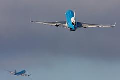 KLM 747-400 being pursued by a company MD-11 (Tim de Groot - AirTeamImages) Tags: blue holland netherlands amsterdam boeing spl klm schiphol 747 b747 md11 747400 koninklijke eham maatschappij luchtvaart twoaircraft
