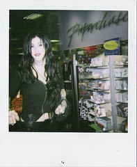 Kat Von D (Nick Leonard) Tags: woman celebrity beautiful lady walking polaroid store pretty lasvegas candid nevada nick bookstore tattoos celeb polaroid600 borders tattooartist 600film katvond nickleonard savepolaroid