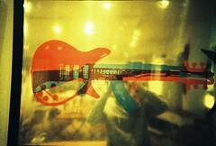 me (benbenbenbenben) Tags: portrait reflection film analog self poster lomo lca xpro lomography crossprocessed gun guitar machine sp
