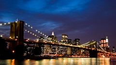 Manhattan Skyline and Brooklyn Bridge (sausyn) Tags: city bridge blue sunset sky newyork reflection water skyline brooklyn river lights skyscrapers dusk blu manhattan postcard ponte cielo luci citt grattacieli colorphotoaward