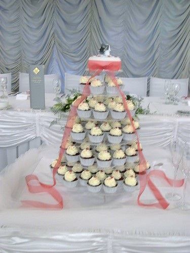 Wedding Cupcake Tower Red Velvet cupcakes and a mini red velvet cake on
