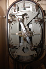 USS Albacore AGSS-569: One of many bulkhead doors, with gears, latches, plates etc. (Chris Devers) Tags: us ship navy newhampshire vessel nh submarine research maritime portsmouth tuna usnavy portsmouthnh 2009 usn uss warship coldwar albacore portsmouthnavalshipyard auxiliary nationalregisterofhistoricplaces ussalbacore 569 cameranikond50 exif:exposure_bias=0ev exif:exposure=0017sec160 exif:focal_length=18mm agss lens18200vr agss569 exif:aperture=f40 camera:make=nikoncorporation exif:flash=autofiredreturndetected praenuntiusfuturi forerunnerofthefuture n89001077 nrhp89001077 camera:model=nikond50 meta:exif=1257920409 exif:orientation=horizontalnormal exif:lens=18200mmf3556 exif:filename=dscjpg exif:vari_program=auto exif:shutter_count=37916 meta:exif=1350400318