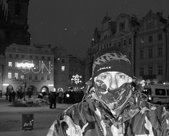 SUN:  snow and an urban snowman  (well what you can see of him)  not too impressed with my holiday choice at that point in time!! (Jus'fi) Tags: old people bw sun snow night square town prague bin czechrepublic policevan january09 jusfi urbansnowman togs24
