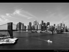 Skyline & Brooklyn Bridge (Natasja ) Tags: new york city nyc newyorkcity travel bridge winter blackandwhite bw usa white ny newyork black skyline brooklyn america canon december manhattan brooklynbridge zwart wit thebigapple 40d viewfrommanhattanbridge canoneos40d