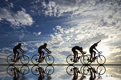 The Finish Line (Lee Sie) Tags: blue sky reflection bicycle silhouette backlight clouds speed trek bicycling cycling cyclists spokes gap chain pack biking winner sillouette tourdefrance bikerace peddle sprint siluetas velodrome pursuit bonk saddle ha