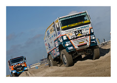 Trucks (roberto_blank) Tags: sea orange cars beach strand cat sand nikon action rally shoreline thenetherlands shore dakar d200 dust nikkor motorracing noordholland vrachtwagen rallycar rallysport ijmuiden racetruck rallycars ginaf 70200f28vr rallyraid trukc dakarsport dakarsportcom