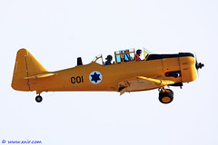 Yellow bird  Israel Air Force (xnir) Tags: plane canon airplane photography eos israel flying is photographer force aircraft aviation military air harvard north flight aeroplane american  texan t6 nir  100400l benyosef 100400    40d wwwxnircom xnir    photoxnirgmailcom