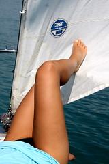 legs (anja277) Tags: summer anna lake holiday girl boat garda sailing legs wind north sail beine gambe gardalake northsail