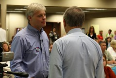 Rep. Thissen speaks to conference attendee (ARRM) Tags: paul rep thissen