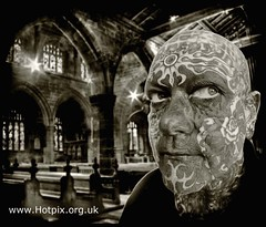 Guardian of the Confessional - Full Face Head Tattoo (Hotpix [LRPS] Hanx for 1.5M Views) Tags: uk england bw white man black sexy slr church monochrome face sex stone tattoo sepia flesh dave club work neck religious photography skull mono warrington eyes cheshire faces head sinister stonework religion great gothic group dramatic photographic medieval tony full canvas dslr tatoo confessional toned society tone facial tinted tatto guardian visage tdk northwich scalp tattoed mrmik fullface hotpix tat2 tattoing 01606 rudheath tdktony hotpixuk mrmiks middlewichrd cheshirecw97by 350792 01606350792 fleshcanvas wwwthewdccorguk thewdccorguk wdccorguk