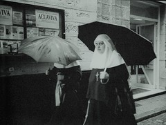 Busted by a Wet Nun with an Umbrella (deepstoat) Tags: bw blur film wet 35mm nikon nuns softfocus busted umbrellas f50 autaut deepstoat