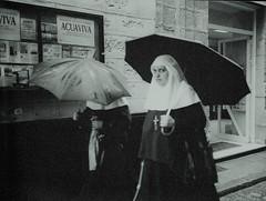 Busted by a Wet Nun with an Umbrella (deepstoat) Tags: bw blur film wet 35mm nikon nuns softfocus busted umbrellas f50 autaut deepstoat