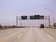 westbound I-80 approaching I-15, 1971 (CountyLemonade) Tags: sign 1971 streetlight ramp saltlakecity freeway signage exit i80 february 1970s i15 gantry interstate80 interstate15 buttoncopy biggreensign