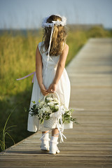 Holidays & Occasions (iconicphotoservices) Tags: ocean flowers wedding sea color beach girl childhood vertical female walking children outdoors person one 1 seaside kid child dress walk fulllength young marriage blond photograph shore bouquet flowergirl rearview stroll caucasian selectivefocus formalclothing holidaysandoccasions