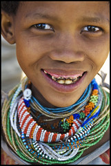 Smile for a Thousand, Kalahari, Namibia (Izla Kaya Bardavid) Tags: africa girls portrait people color girl smile face rural happy eyes nikon san teeth traditional joy teenager ethnic adolescent namibia kalahari afrique jewellry adolescents enjoylife bushmen kalaharidesert sanpeople iloveyoursmile