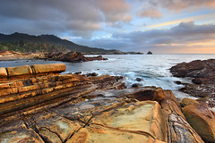 Bird Rock - Point Lobos, California (PatrickSmithPhotography) Tags: ocean california travel sunset wallpaper vacation sky usa seascape storm beach nature rock canon landscape geotagged monterey interestingness bigsur wave carmel pebblebeach 5d pacificgrove asilomar pointlobos mkii markii 1740l mark2 frhwofavs 5dmkii photocontesttnc10