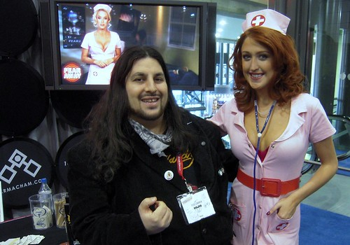 Me standing with So Cal Val of TNA wrestling dressed as a nurse promoting the video game F.E.A.R. 2