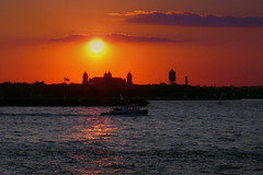 Ellis Island Memories (ecco9494) Tags: nyc newyorkcity sunset orange color silhouette nikon vivid explore jol ellisisland d300 burningskys golddragon theunforgettablepictures águasdivinas