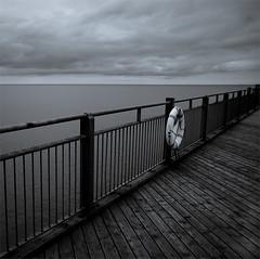 Pier (luns_spluctrum) Tags: ocean life uk sea blackandwhite bw white black water coast pier blackwhite suffolk interestingness interesting north ring bouy picturesque southwold buoyant