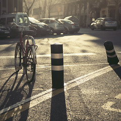 (uwajedi) Tags: barcelona street light sunset shadow sun lines bike bicycle square spain europe shadows parking streetscene espana catalunya asphalt pilon longshadows ljex