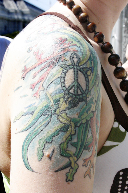Turtle Peace Sign Tattoo. Photo by Sherrie Thai of ShaireProductions.