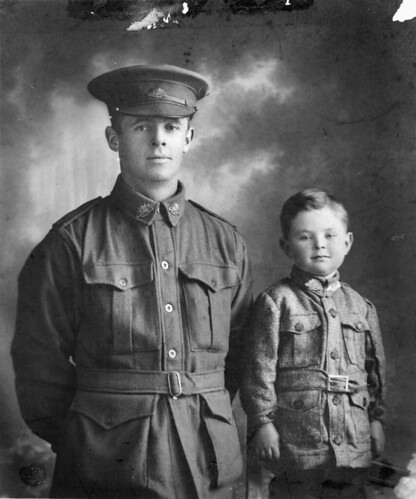 Studio portrait of 1626 Private (Pte) Walter Henry Chibnall, 10th Light Trench Mortar Battery, pictured with his son William Beresford (Billy) Chibnall