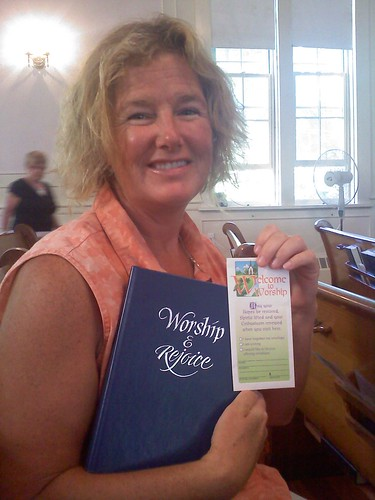 Mo, holding the hymnal dedicated to my parents