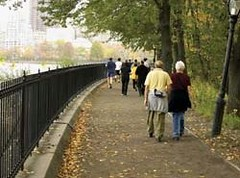 seniors walking safely by the river (photo courtesy of EPA)