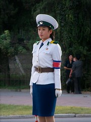 Portait of a Traffic Girl in Pyongyang North Korea DPRK (Ray Cunningham) Tags: winter girls summer ballet tourism beauty del women uniform republic traffic control north police korea tourist peoples direction korean american autos crossroads democratic norte pyongyang corea dprk koryo     raycunningham zaruka raymondkcunninghamjr raymondkcunninghamjr