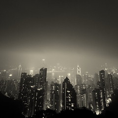A strange perspective of Gotham City (... Arjun) Tags: china city light urban bw 15fav panorama hk mist distortion storm strange rain misty fog sepia clouds 1025fav 510fav square hongkong iso3200 lights town scary lomo lomography haze asia cityscape nightscape bend cloudy ghost capital perspective foggy surreal monotone 100v10f eerie panoramic 2550fav squareformat batman metropolis haunting bent thepeak hazy gotham  toned f8 murky slant steamy darkknight victoriapeak 2010 conurbation municipality gothamcity monchrome slanting metropolitian 17mm 500x500 hongkongsar canonef1740mmf4l bluelist perspectivedistortion canoneos5dmarkii canon5dmarkii mistyhongkong