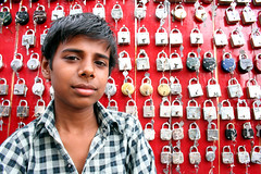 Padlock seller  Bundi (Jules1405) Tags: world travel portrait people india face kids children asian kid asia indian asie padlock indien seller rajasthan inde asiatique chil bundi reflectionsoflife lovelyportrait jules1405 unseenasia overtheexcellence
