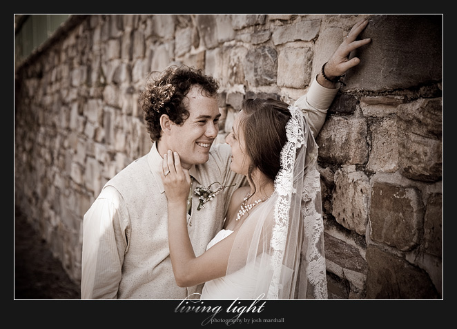 A tender moment for the couple, in front of a stone wall on King Street, Newcastle.