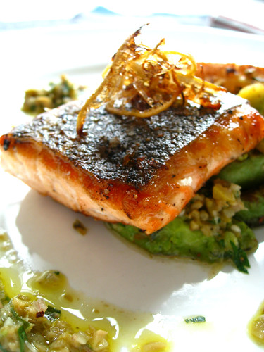 Pan roasted organic salmon with caramelized avocado, fried lime shave and anchovy-olive dressing