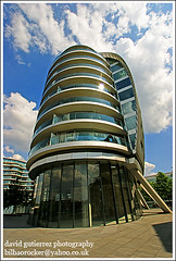 London Albion House (davidgutierrez.co.uk) Tags: city blue light sky urban house building london lines thames architecture clouds buildings spectacular geotagged photography design photo arquitectura cityscape riverside image sony centre curves perspective cities cityscapes center front structure architectural explore foster 350 wharf page londres architektur sensational metropolis alpha topf100 frontpage londra impressive dt riverwalk albion municipality edifice translucency cites f4556 100faves 1118mm albionwharf mywinners platinumheartaward leisurefacilities glassbalustrades asymmetricalcrescent sonyalphadt1118mmf4556 sony350dslra350