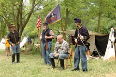A drunkard ? conspirator ? regardless - he is in trouble (sirchuckles) Tags: war days civil 2009 arrested handcuffed guarded wauconda