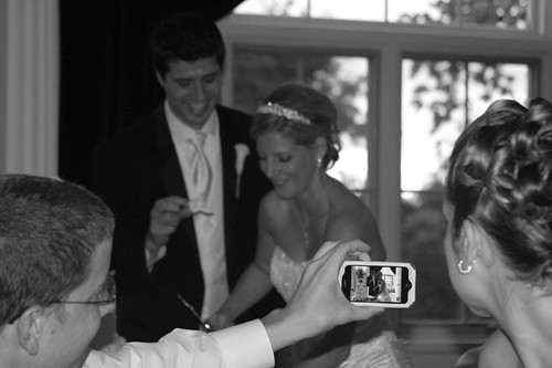 cutting the wedding cake and iPhone